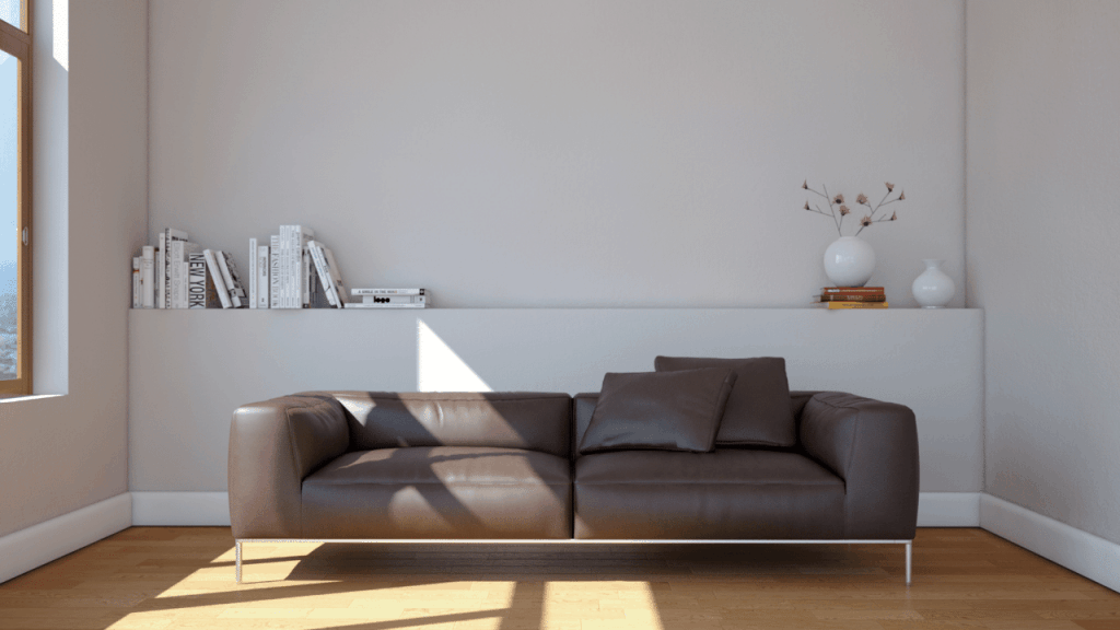 Brown Leather Sofa with Gray Wall Decor